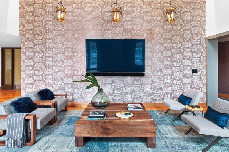 a SENTIENT contemporary designed custom wood beam coffee table and two caribou luxury chairs in a city tower apartment