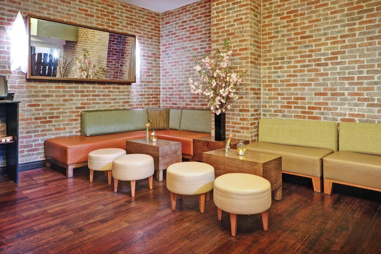 custom SENTIENT contemporary designed upholstered banquette and stools with tables at luxury bread and tulips restaurant