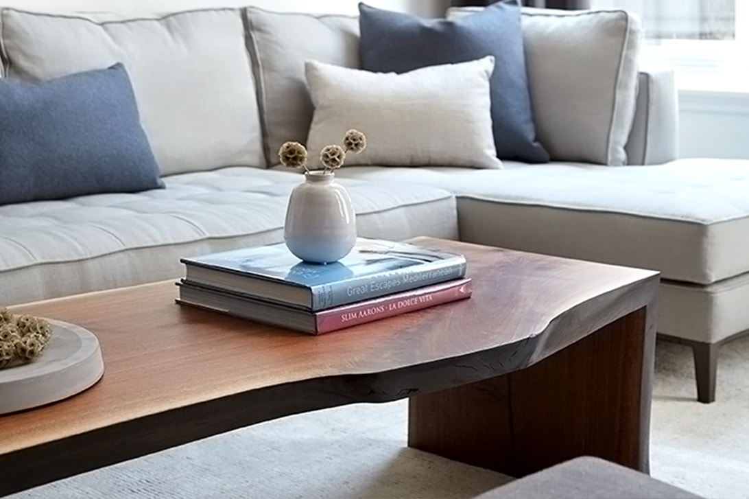 a contemporary designed SENTIENT Long solid walnut wood live edge custom coffee table with luxury sectional sofa