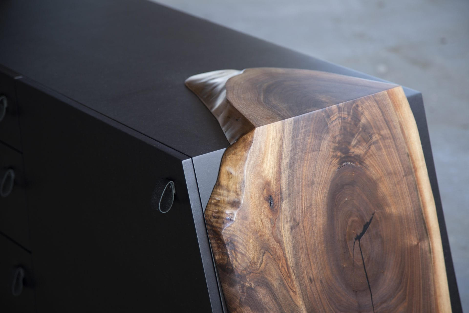 a SENTIENT contemporary designed time when custom console detail with of live edge