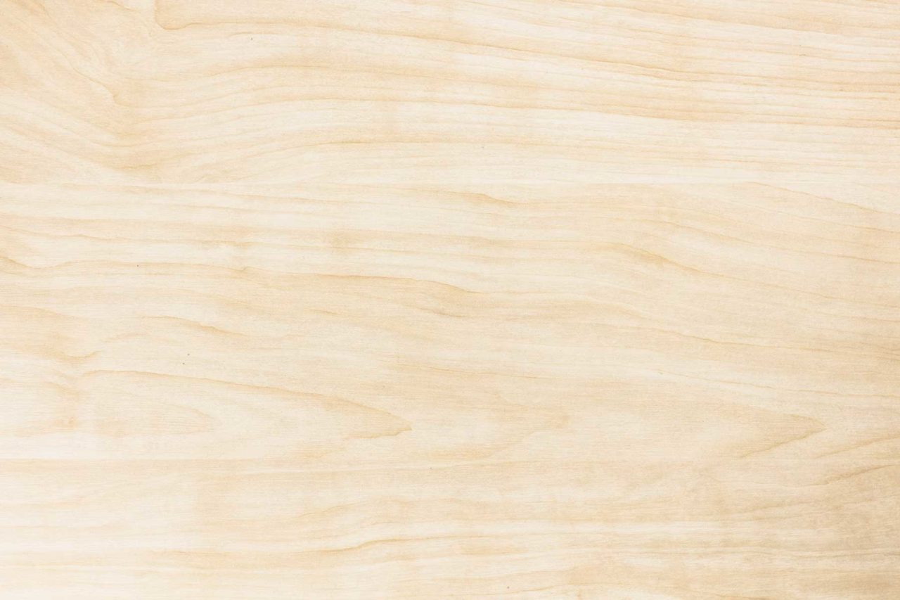 a solid light stained luxury SENTIENT maple wood striated grain detail