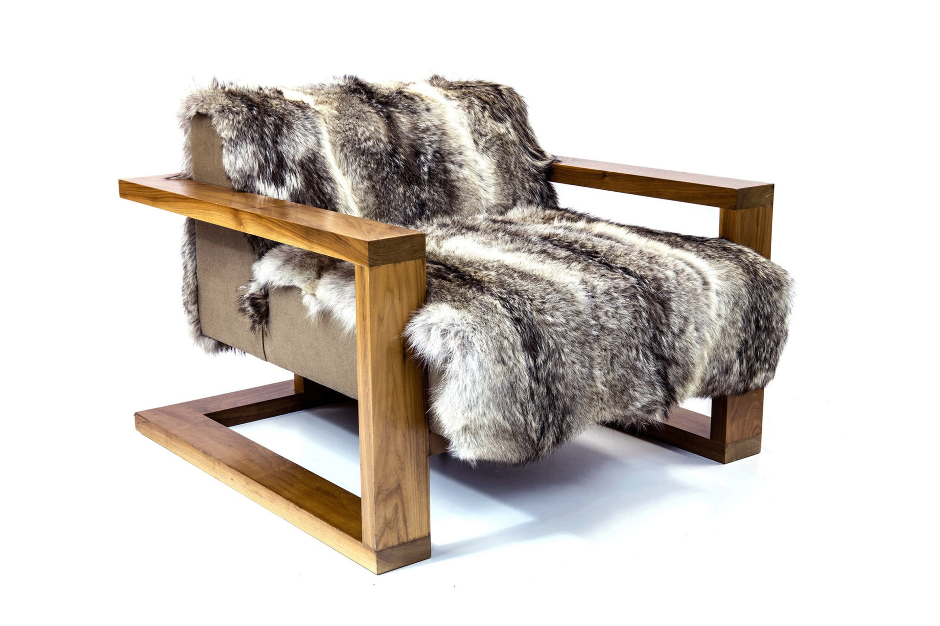 a SENTIENT contemporary designed upholstered Caribou custom lounge chair with wood arms and luxury fur