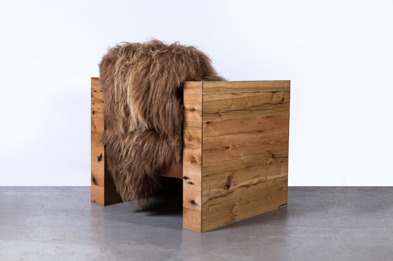 a SENTIENT contemporary designed joojay armchair with luxury Icelandic wool and custom reclaimed oak frame back view