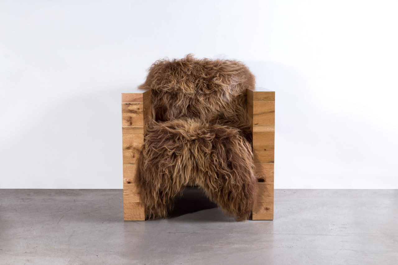 a SENTIENT contemporary designed joojay armchair with luxury Icelandic wool and custom reclaimed oak frame front view