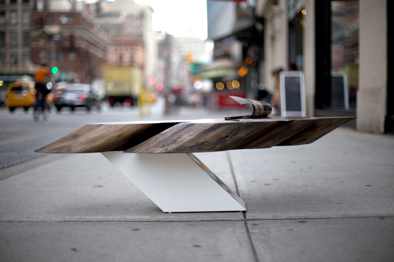 a contemporary designed SENTIENT Zora live edge coffee table with extending solid wood top on luxury white base