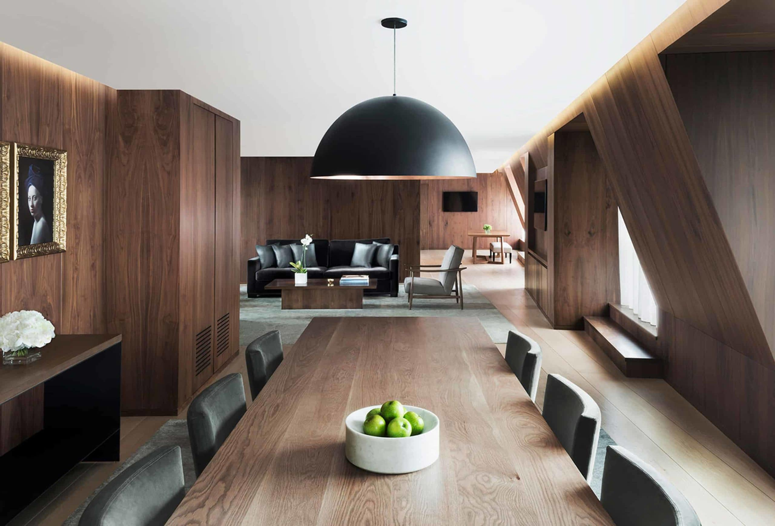 a walnut custom SENTIENT contemporary designed dinning table in walnut clad London edition hotel penthouse